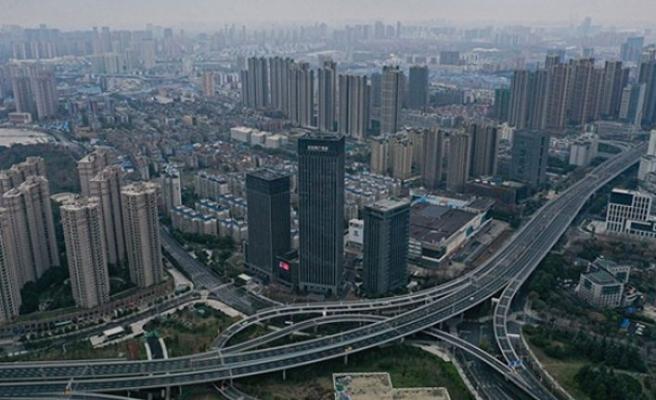 Kovid-19'un kökenini araştıracak DSÖ Heyeti, Çin'in Vuhan kentine ulaştı