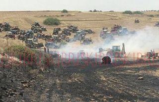 Traktörünü alan, yangına koştu