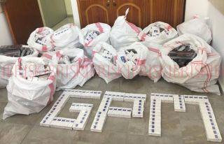 Girne'de binlerce paket kaçak sigara ele geçirildi