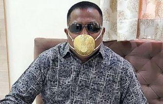 Para bol olunca korona virüse karşı altın maske takıyor